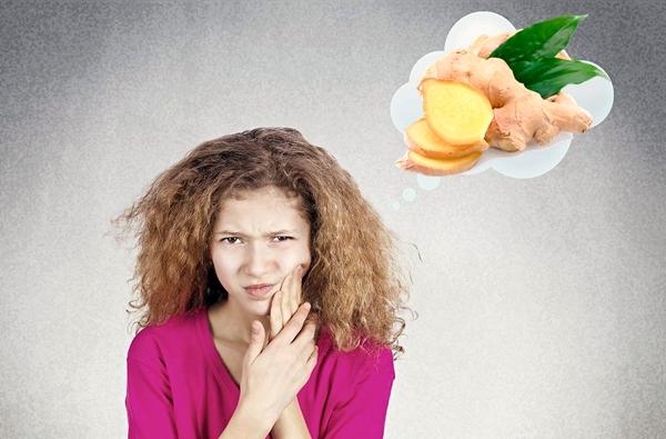 девушка с зубной болью думает про имбирь